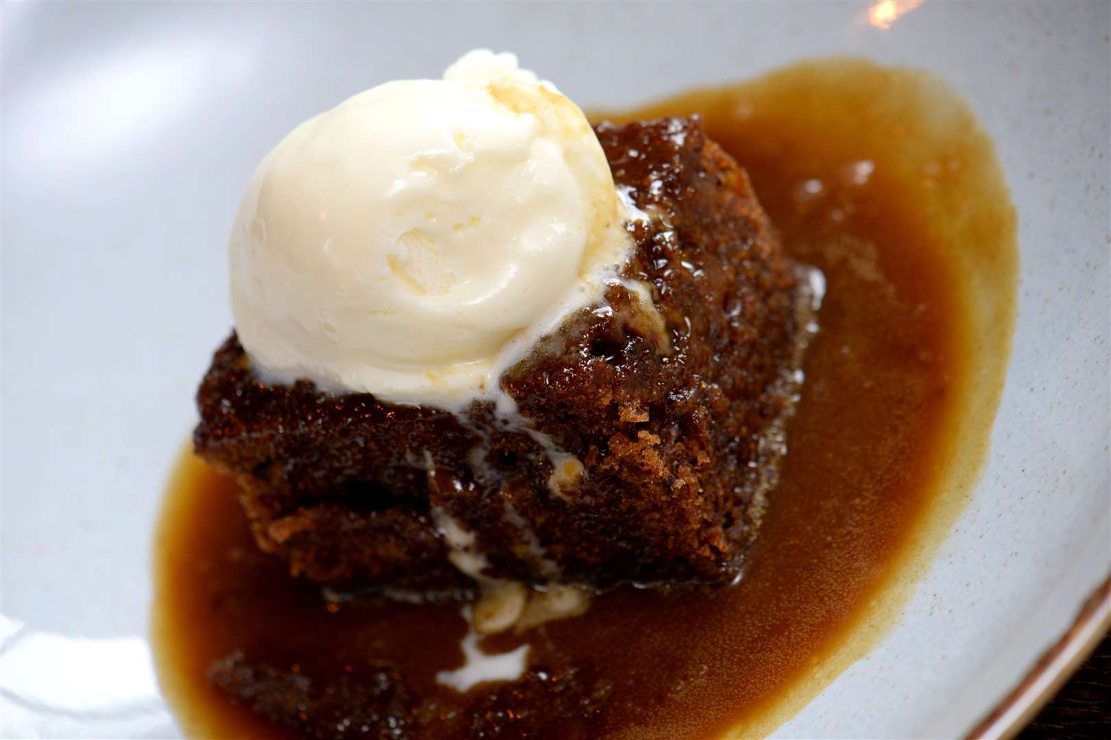 Sticky toffee pudding with butterscotch sauce and vanilla ice creamPic: Vikki Lince (7656572)