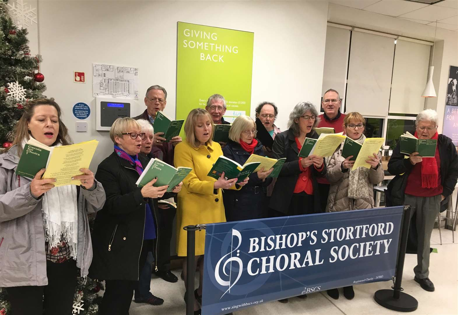Carolling choristers help shoppers part with their cash for Stortford causes