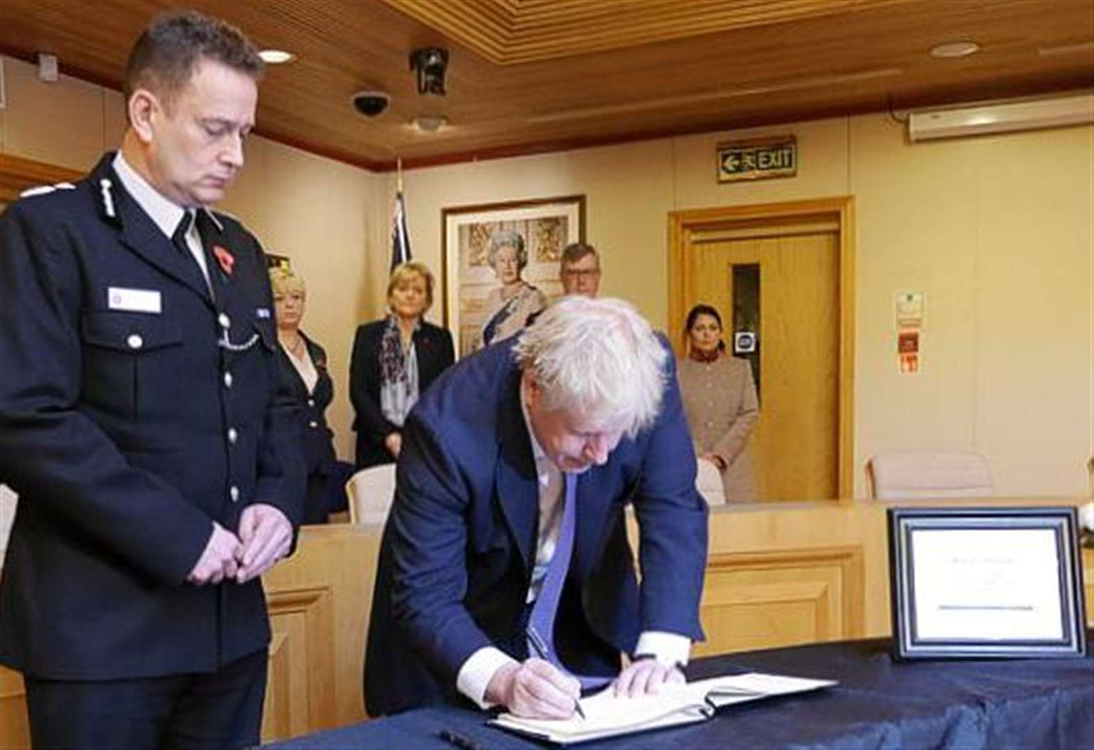 Boris Johnson signs book of condolence for 39 lorry trailer victims in Essex