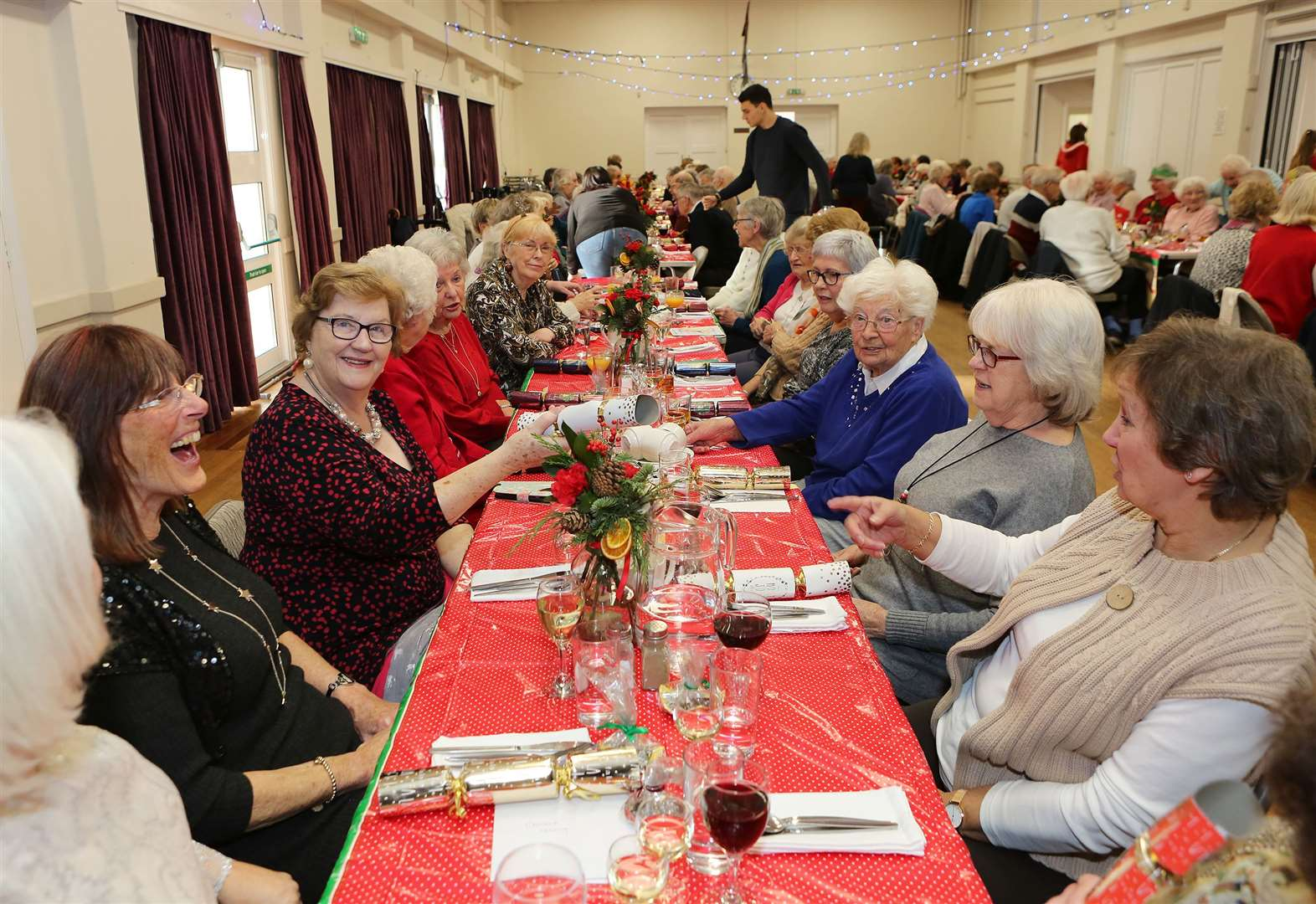 Community pulls together for a cracker of a festive feast for 102 lonely OAPs