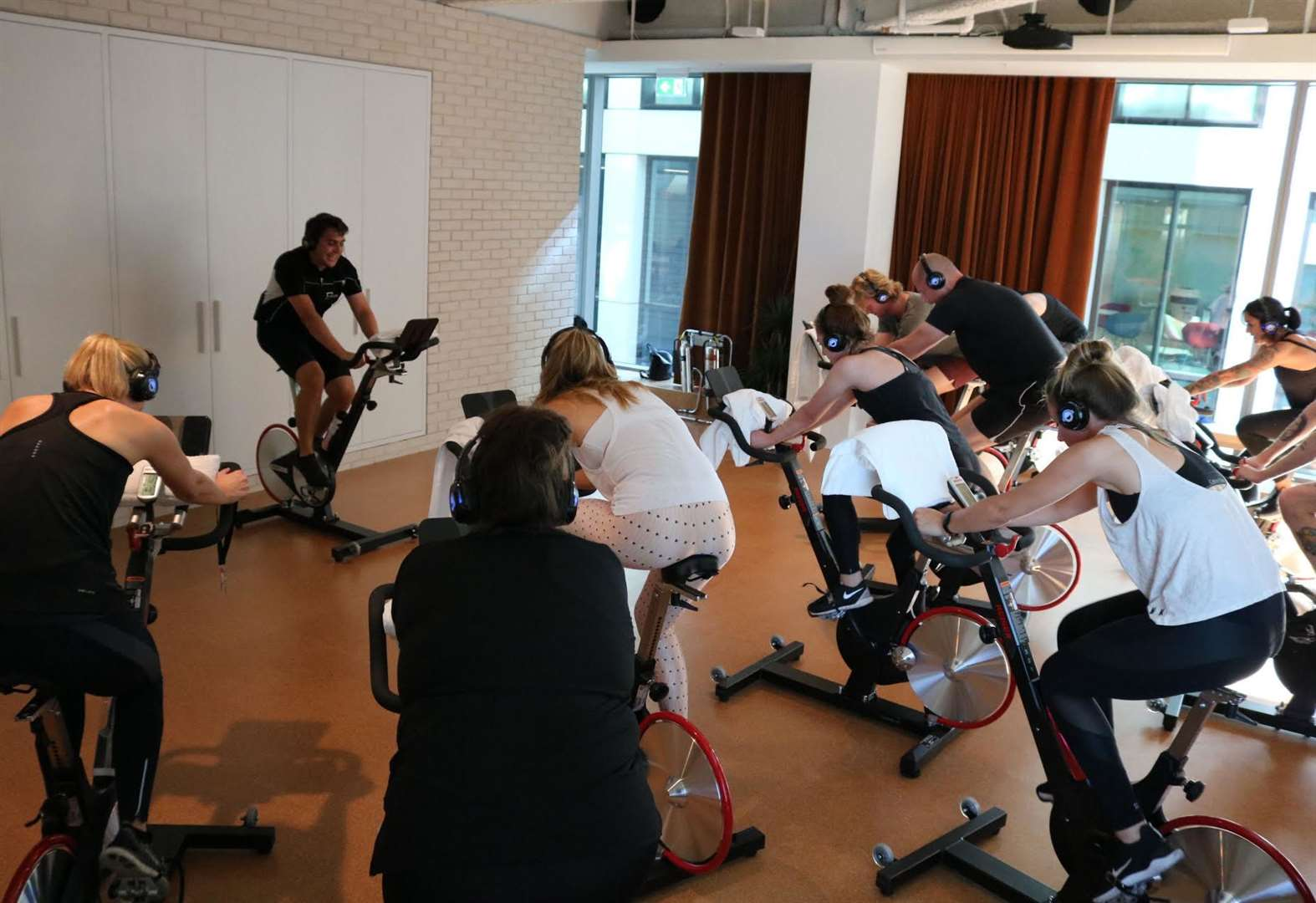 Friends get on their bikes to bring spin classes to busy people