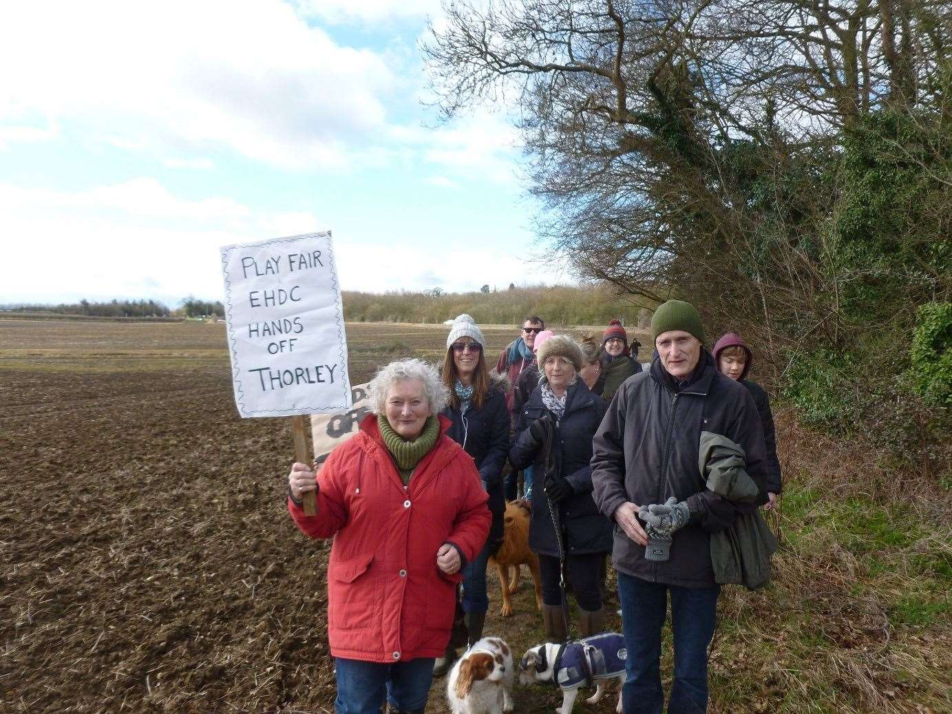 Residents walking on the field alongside Whittington Way in protest at Countryside's planning application to build 750 homes there. Picture: Roger and Sandy Halford (7676439)
