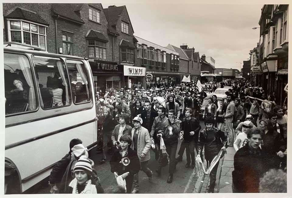 Jubilant fans follow the Bishop's Stortford team coach along South Street. Picture: George Francis