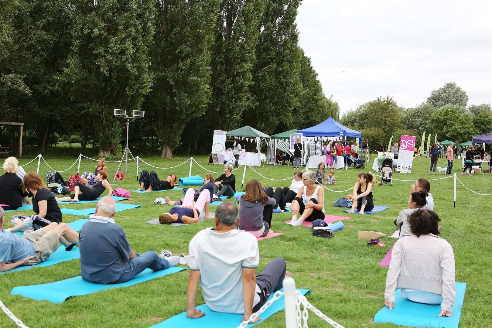 Goodness In The Park, Castle Park, Bishops Stortford. Rebecca Young and Tony Boardman taking a Pilates class.. (36522623)