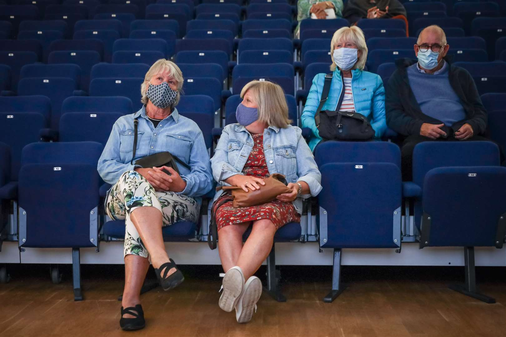 Masked and socially distanced cinema-goers at Saffron Screen