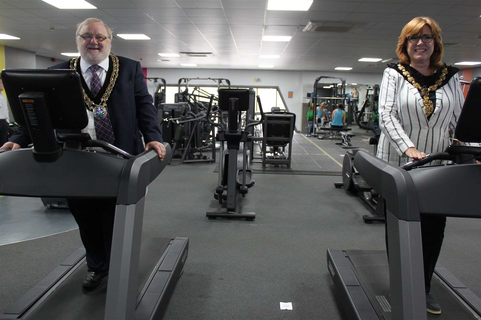 Uttlesford District Council chairman Cllr Martin Foley and Saffron Walden mayor Heather Asker get to work on the treadmills (39850304)