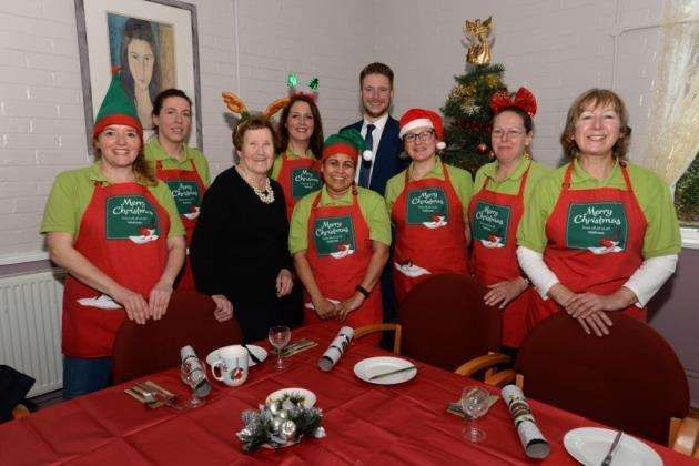 New Apton Centre, Bishops Stortford. Partners from Waitrose help out during Age Concerns 2017 Christmas dinner. Age Concern Chairman Angela Alder with Waitrose elves l-r: Tracy Whitfield, Stacey Kindall, Samantha Syde, Vina Patel, Dave Goodacre (Waitrose dep. branch manager), Gresh Evans, Kisty Daines (c) and Heather Cann. Pic: Vikki Lince