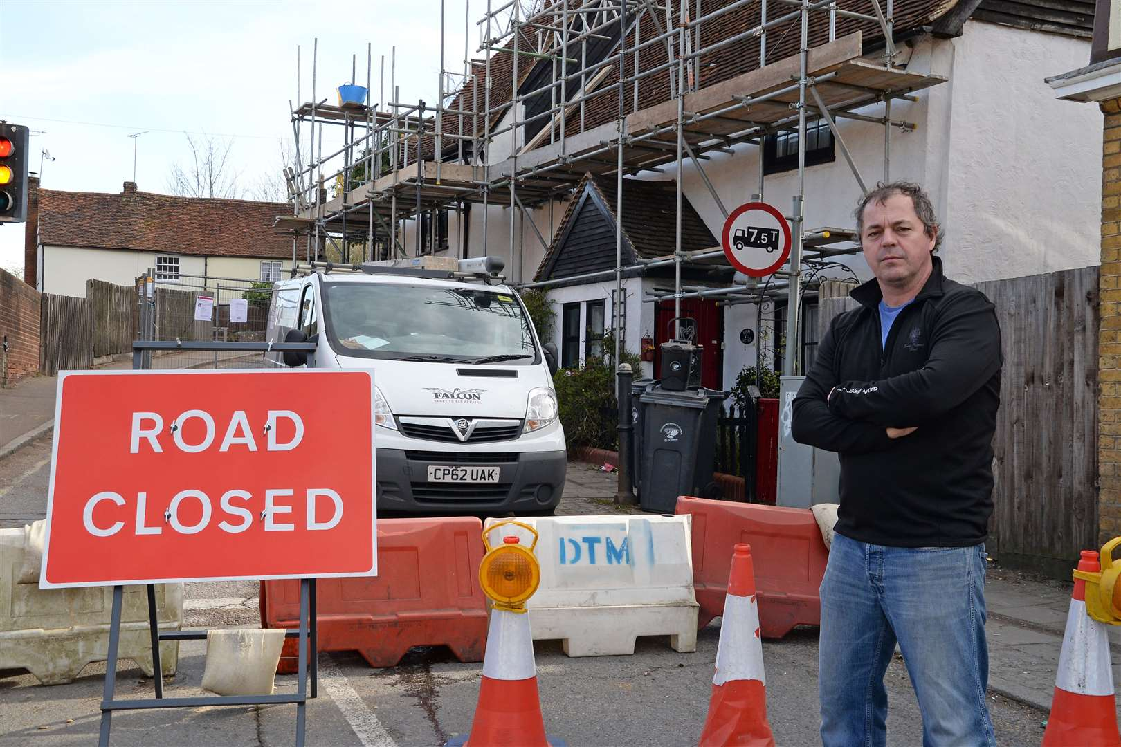 Grove Hill, Stansted. Peter McDonnell outside his home. Grove Hill has been closed for a month so that scaffold could be erected to repair damage done by an oversized lorry. .Pic: Vikki Lince. (44228822)