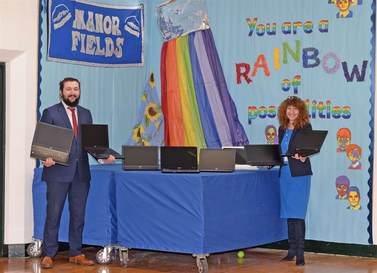 James Moore from Genmar with Manor Fields head teacher Helen Smith and some of the laptops donated. Pic: Vikki Lince. (44226424)