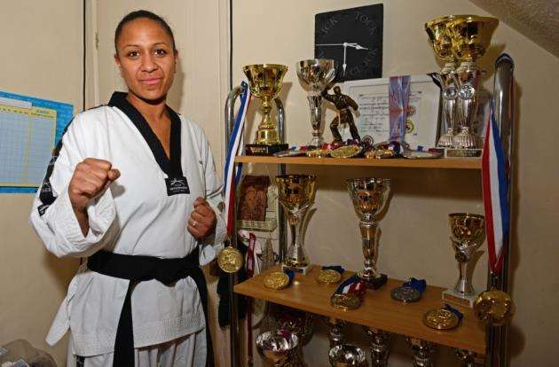 Tyha beside the trophy and medal cabinet at her home in Bishops Stortford Pic: Vikki Lince