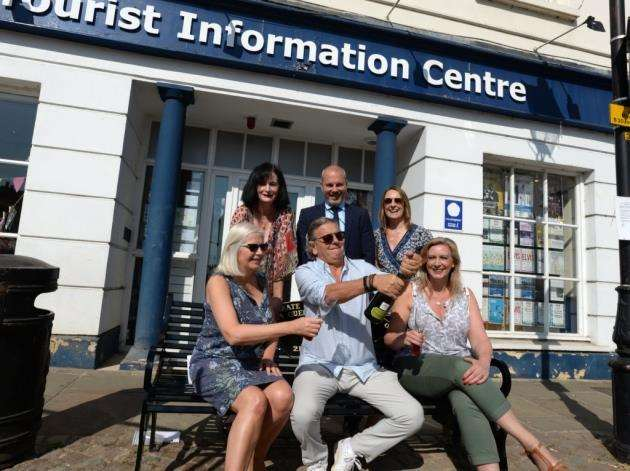 Perry Colman, of Elements and Urban Spa, breaks open a bottle of bubbly, flanked by Stortford BID board chair Karen Burton, left, of Karens Cakes, and Click Clicks Lindsey Trundle, with, back from left, Indie news editor Sinead Corr, and Chris Smith and Paula Beades of East Herts Council Picture: Vikki Lince