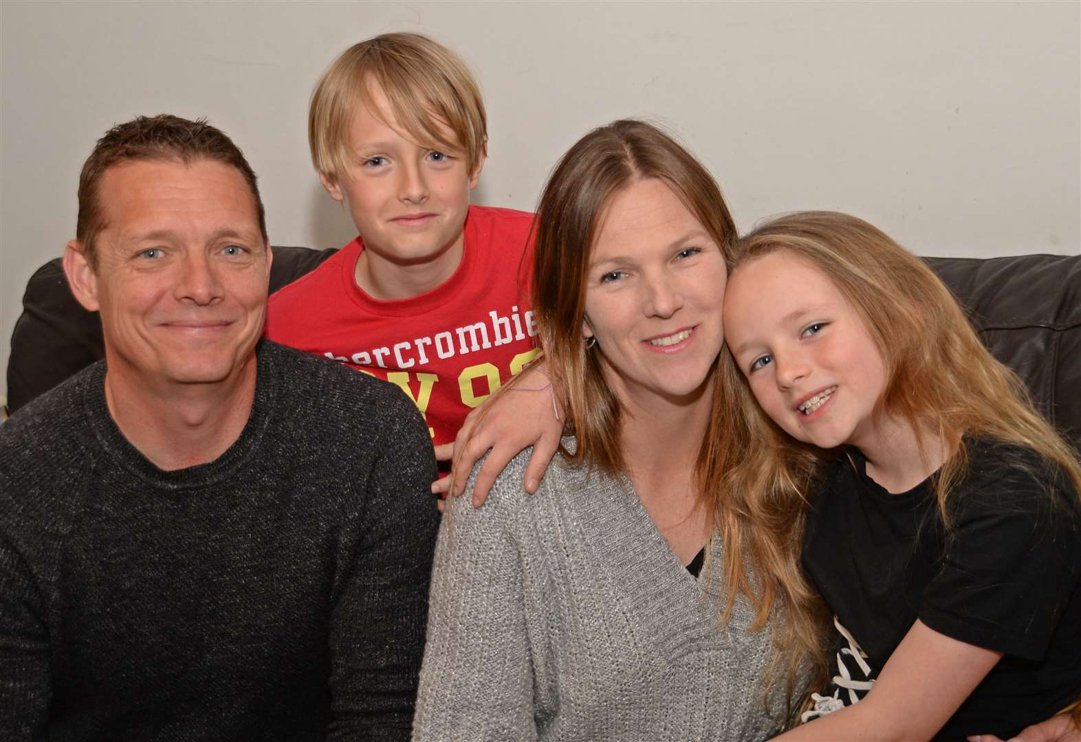 Beth Purvis, aka Bowel Warrior, who is writing a new column for the Indie about living with stage 4 cancer, pictured with husband Richard and their children Joe and Abi Picture: Vikki Lince (10278293)