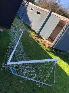 Goal posts lay bent and damaged (45762031)