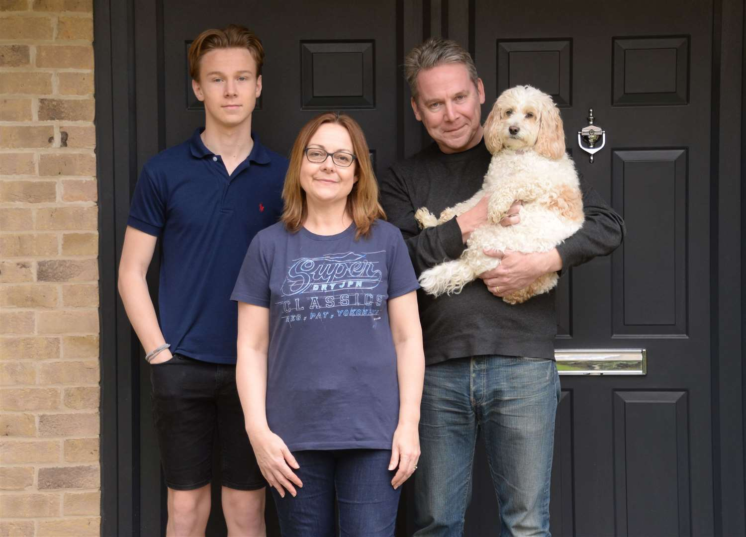The Wilson family cope with lockdown – Cate with husband Scott, son Jacob and Lily Pickle the dog. Picture: Vikki Lince (33947563)
