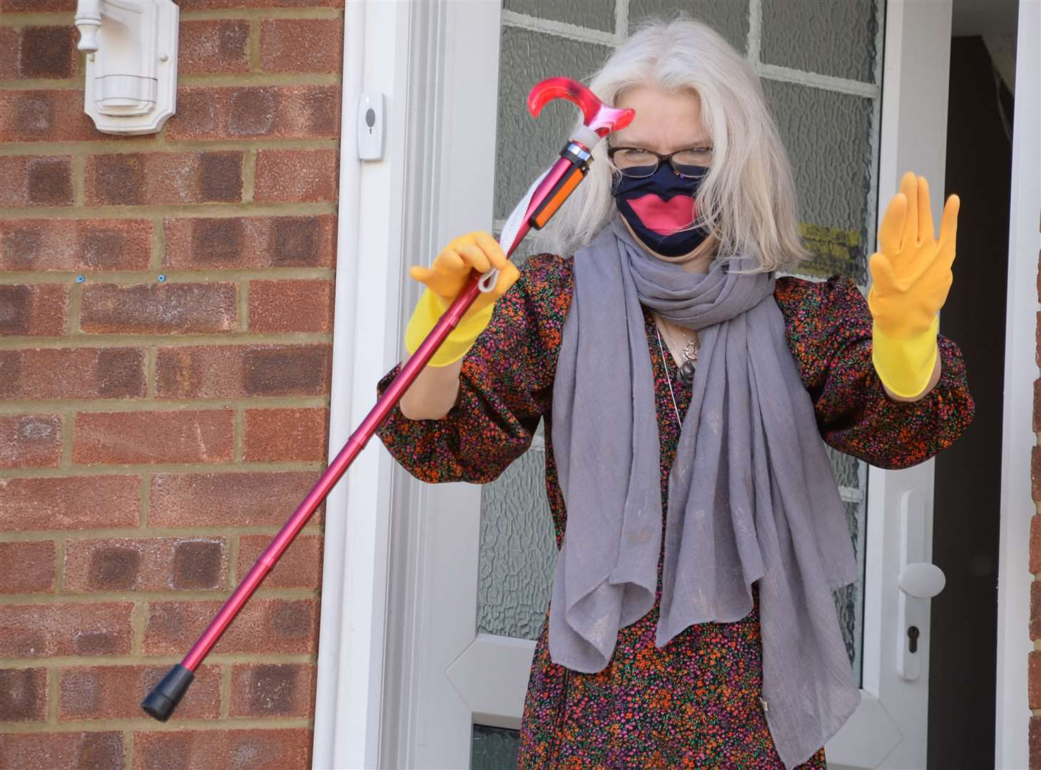 Parkinality columnist Julie Walker, pictured shooing photographer Vikki Lince away from her door, is continuing to shield