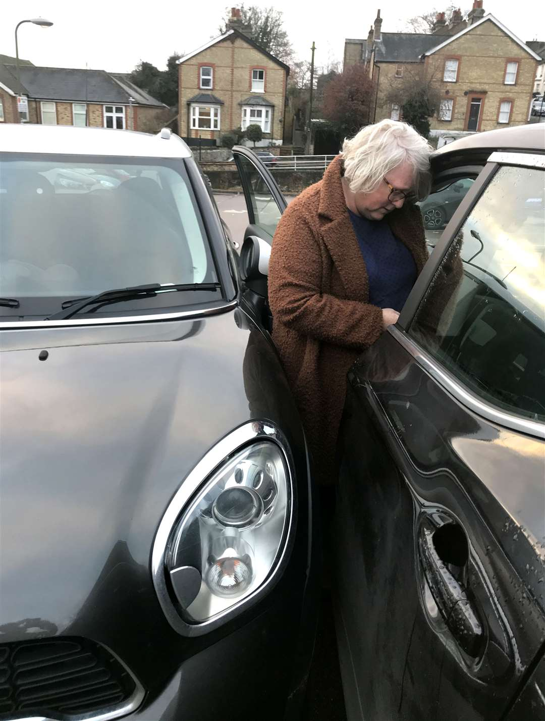 Thornbera Road, Bishop's Stortford. Helen East was trapped in against her car by a runaway Mini in Apton Road car park. .Helen trapped between the cars. .Pic: Vikki Lince. (26731536)