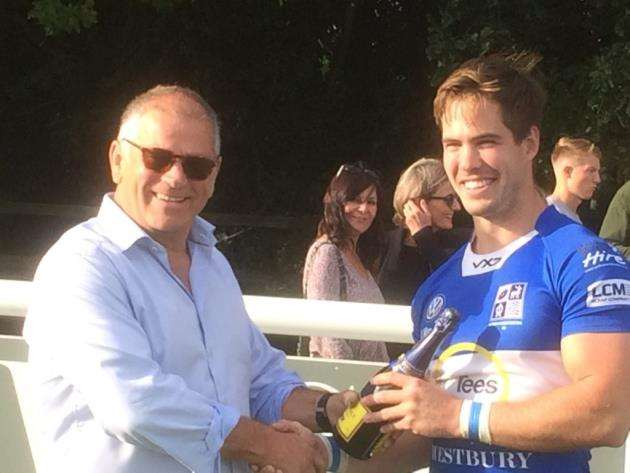 Winger Rob Duff receives his man of the match award from sponsor Westbury Garden Rooms