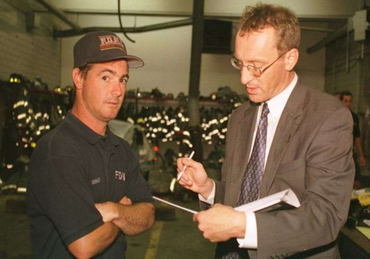 Andy Lines talking three days after the 9/11 attacks to New York fireman Mike Kehoe, who escaped from the World Trade Center seconds before its collapse (50981343)
