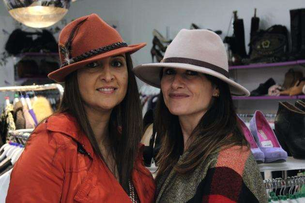 Karen Millen orange raincoat size 12 £25, checked wrap £6, hats from a selection Picture: Sarah Lord