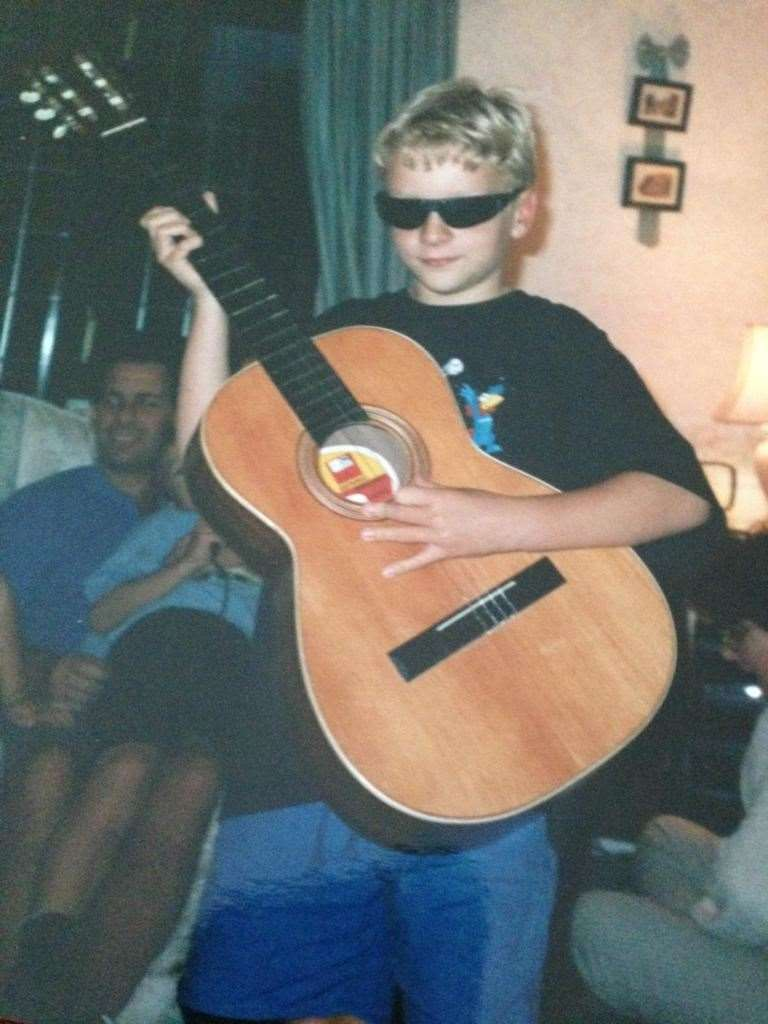 """It was around 13 or so that I discovered music and wanted to play it. Mum and Dad had bought me a Spanish-style guitar from Argos for Christmas."""