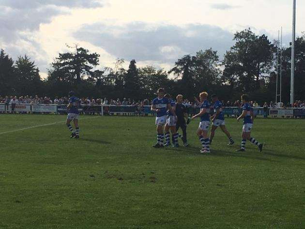 James Apperley is congratulated by his team-mates after scoring Stortfords fifth try