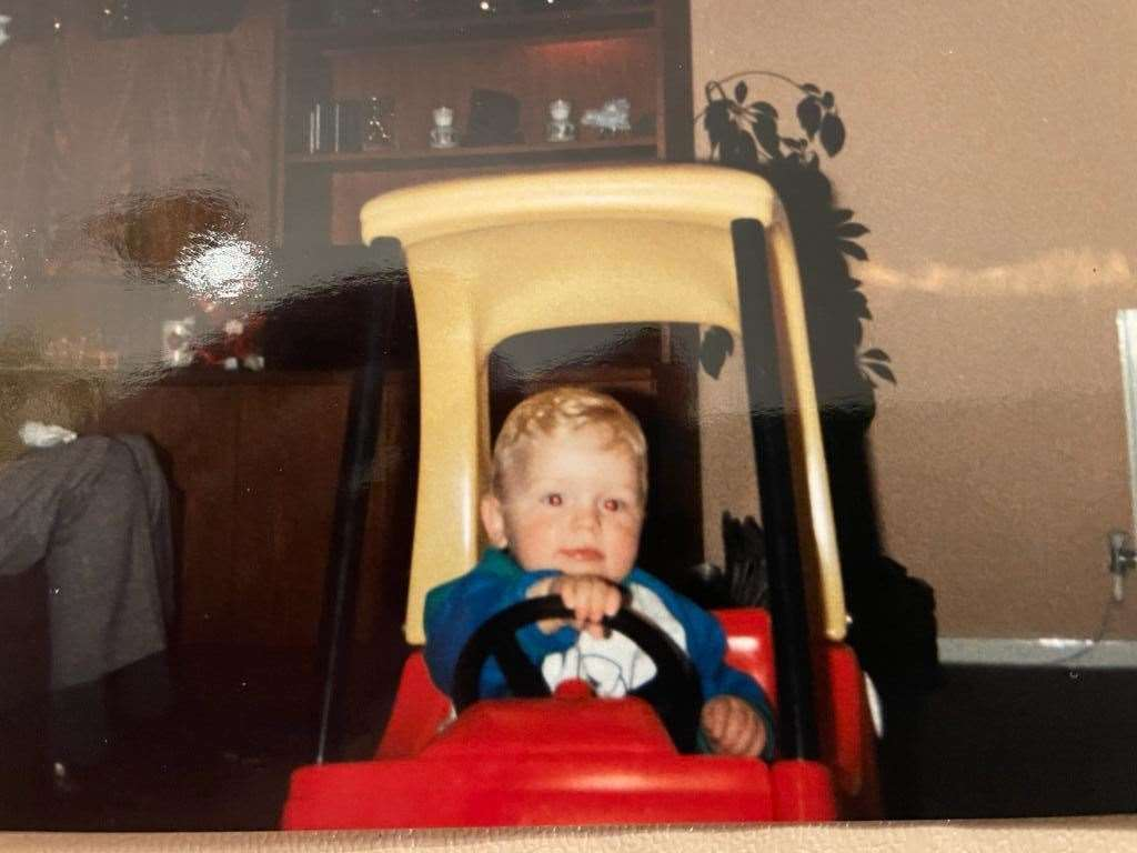 Tom in his Little Tykes red and yellow toy car, pretending to be Finnish Formula One world champion Mika Hakkinen