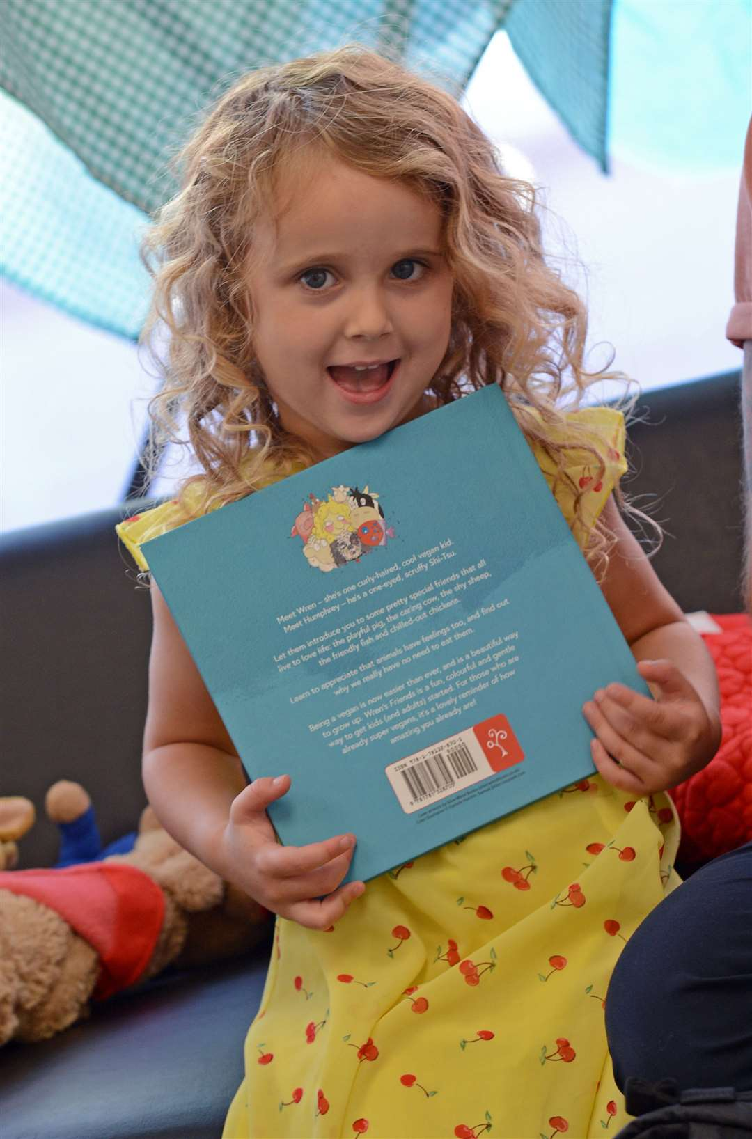 Four-year-old Wren-Ophelia Claydon with the picture book inspired by her, Wren's Friends: A Fun Vegan Adventure Picture: Vikki Lince (15625284)