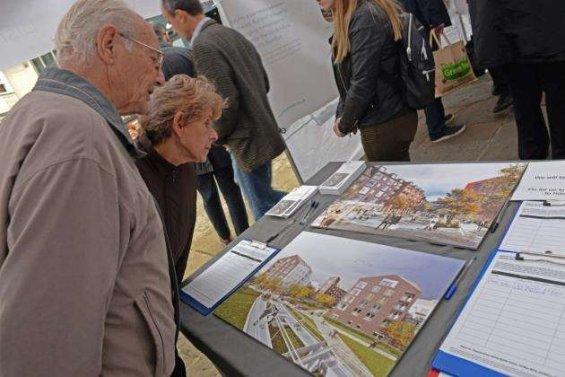 Market Square, Bishops Stortford. Solum show off their revised plan for the regeneration of the Goods Yard. Members of the public check out the plans and talk to Solum Reps. Pic: Vikki Lince