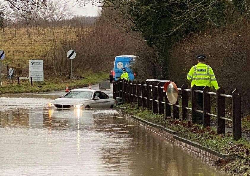 A car stranded in floodwater between the Hadhams at the junction with Bromley Lane. Picture: @EastHertsPolice on Twitter (43960018)