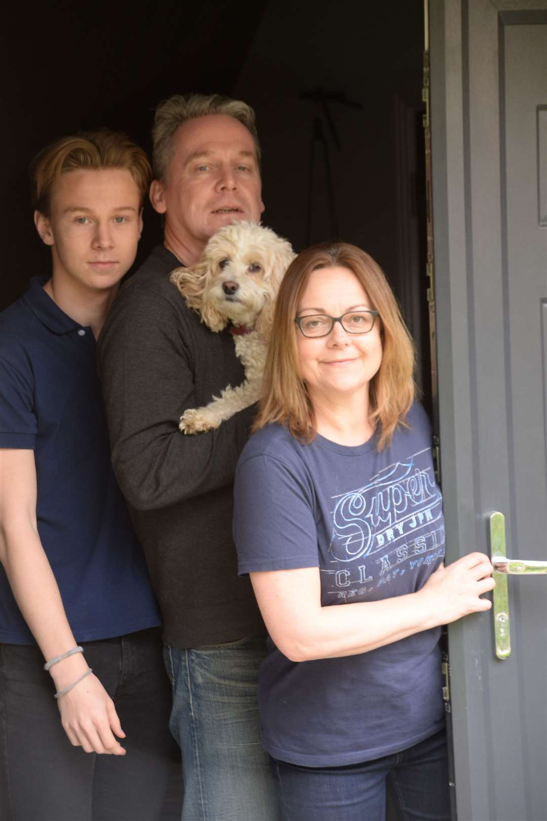 The Wilson family coping with lockdown – Cate with husband Scott, son Jacob and Lily Pickle the dog. Picture: Vikki Lince (33947596)