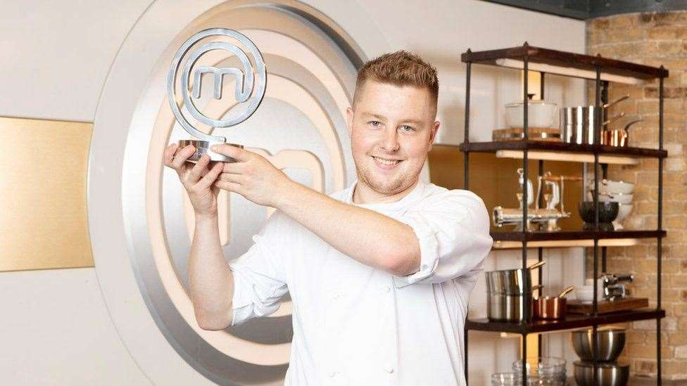 Masterchef: The Professionals champion Alex Webb with the winner's trophy