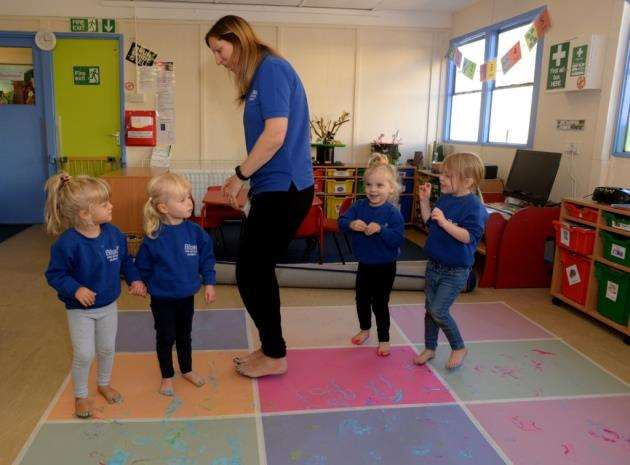 Blues Pre-School, Bishops Stortford. Pre-school celebrating anniversary. Deputy Manager Donah Shannon with pupils doing a paint and dance session. Pic: Vikki Lince