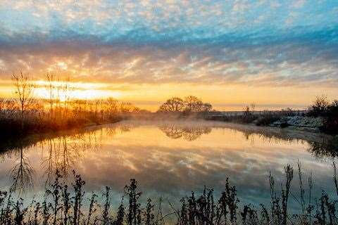 Sunrise on Saturday over the pond at Spellbrook. Picture: David Francis (44754823)