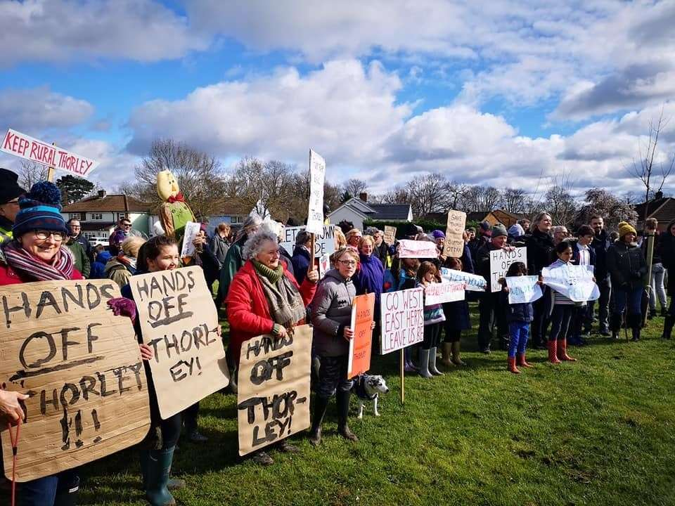 Protesters gather on the green in Twyford Park after their walk. Picture: Sandy Halford (7675407)