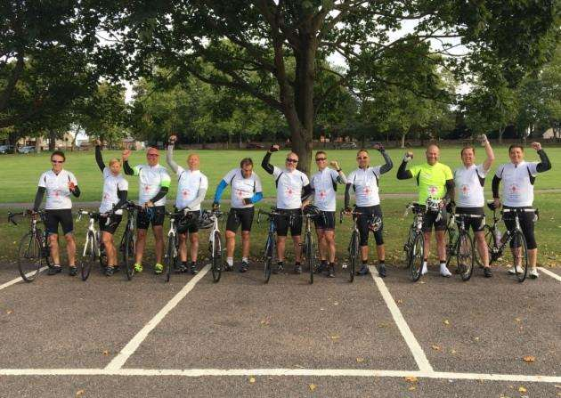 The Enable team that cycled from London to Brussels to raise money for Grove Cottage