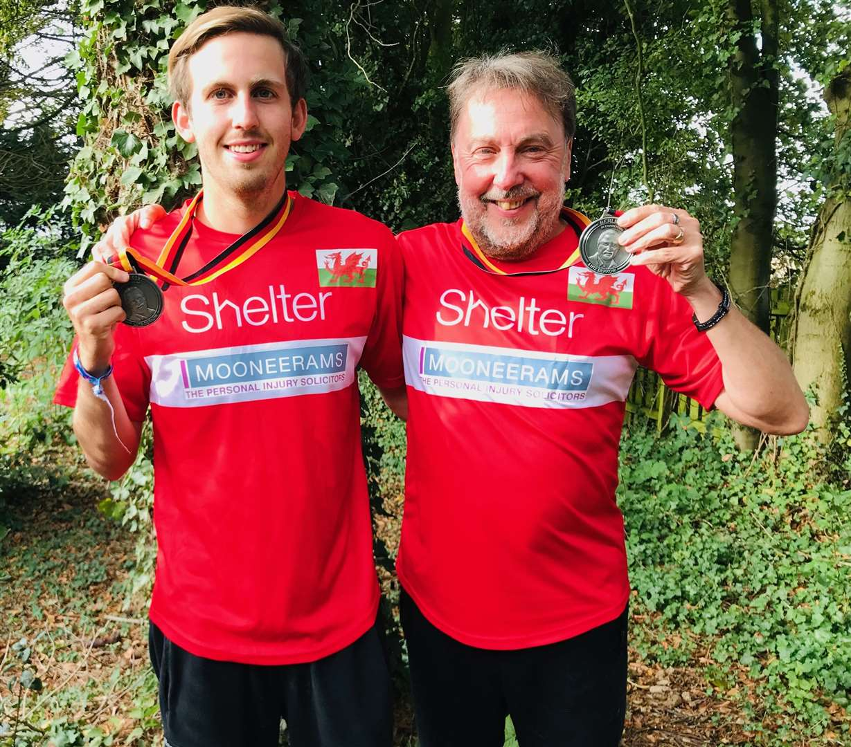 Carl and son Ben with their medals after completing the Berlin Marathon on September 29 last year (28863086)